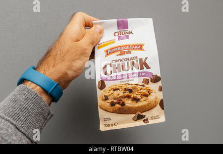 PARIS, FRANCE  - OCT 5, 2017: Male hand holding delicious Chocolate Chunk bag made by  - Stock Photo