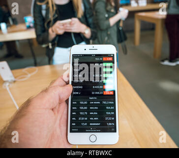 PARIS, FRANCE - SEP 22, 2017: New iPhone 8 and iPhone 8 Plus, as well the updated Apple Watch, Apple TV goes on sale today in Apple Store with customer POV at Apple AAPL stock price  - Stock Photo