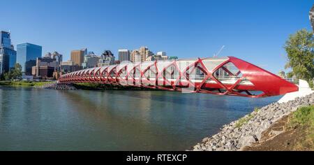 The Peace Bridge spanning the Bow River in Calgary, Alberta. The pedestrian Peace Bridge was designed by celebrity architect Santiago Calatrava. - Stock Photo