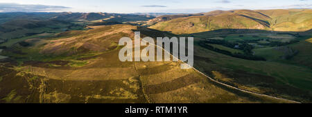 Aerial image showing Glenholm and the Upper Tweed Valley with the hills Drumelzier Law and Logan Head. - Stock Photo