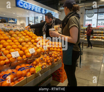 A miniature Whole Foods Market in the Chelsea neighborhood of New York on opening day, Friday, March , 2019. Located in the former space occupied by Whole Foods' beauty and health products the miniature location sells snacks and prepared foods as well as hosting a coffee and kombucha bar. Amazon, the owner of Whole Foods Market, announced it will be opening a chain of supermarkets with a price point lower than WFM and with a smaller footprint, although not as small as this store. (© Richard B. Levine) - Stock Photo