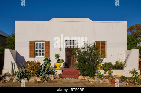 Traditional Karoo home architecture. White concrete facade with succulent garden. In Prince Albert, South Africa - Stock Photo