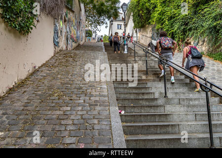 People climbing the steep steps at Rue du Calvaire, which connects Rue Gabrielle and Place du Tetre at  Montmartre ,Paris - Stock Photo