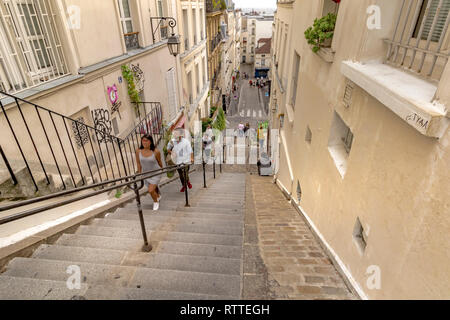 People climbing the steep steps at Rue Drevet , which connects  Rue des Trois Frères with  Rue André Barsacq , Montmartre ,Paris - Stock Photo