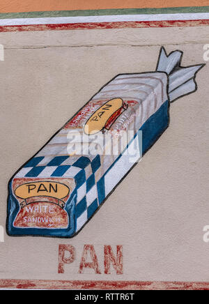 grocery items painted on wall of Country Club Market, Albuquerque, New Mexico (loaf of bread) - Stock Photo