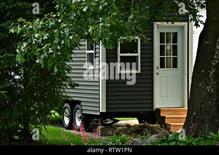 Closeup exterior view of an affordable eco friendly tiny house on wheels - Stock Photo