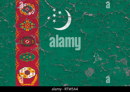 Flag of Turkmenistan painted on cracked dirty wall. National pattern on vintage style surface. - Stock Photo