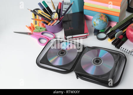 stack of CDs and school supplies isolated on white background.photo with copy space - Stock Photo