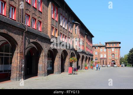 KATOWICE, POLAND - SEPTEMBER 5, 2014: People visit Nikiszowiec historic district in Katowice, Poland. With 304 thousand people (2013), Katowice is the - Stock Photo