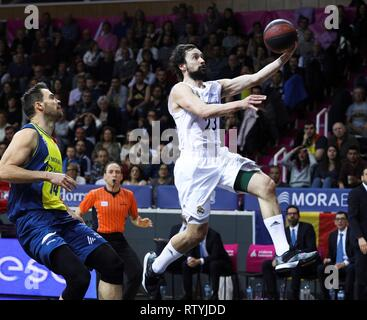 Andorra La Vella, Andorra,  03rd Mar, 2019. Real Madrid's basketball player Sergio Llull (R) tries to score in presence of MoraBanc Andorra's Serbian Oliver Stevic (L) during their Endesa League basketball match at Poliesportiu of Andorra, 03 March 2019. Credit: Fernando Galindo/EFE/Alamy Live News - Stock Photo
