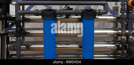 Plastic piping with blue holders. industrial background - Stock Photo
