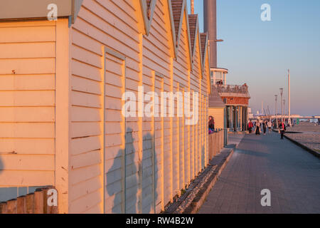 Wooden huts at Brighton Beach England in the evening - BRIGHTON, UNITED KINGDOM - FEBRUARY 27, 2019 - Stock Photo
