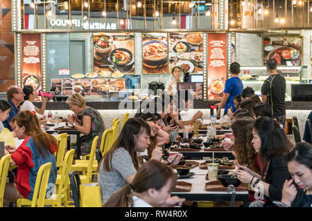 Singapore - January 28, 2019 : - People have their meal from different fast food chains on a food court in The Shoppes at Marina Bay Sands  in Singapo - Stock Photo