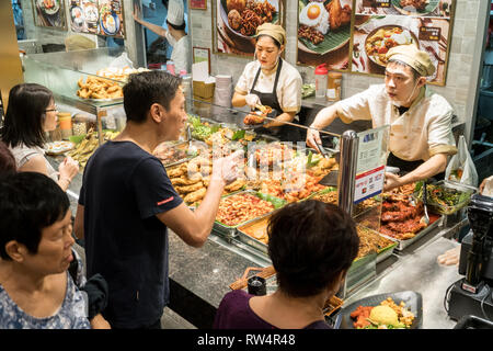Singapore - January 28, 2019 : - Customers buy prepared meal on a food court in The Shoppes at Marina Bay Sands  in Singapore - Stock Photo