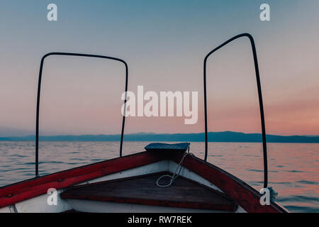 Sunset boat ride on one of Europe's oldest and deepest lakes- UNESCO World Heritage Site of Ohrid, North Macedonia - Stock Photo