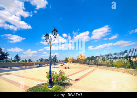 Pedestrian colorful street and road along Aghlabid Basins, located outside city walls. Kairouan, Tunisia. North Africa - Stock Photo