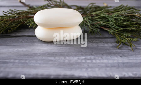 Closeup of soap on an old wooden background. Spa treatments, greens.Skin care beauty concept. - Stock Photo