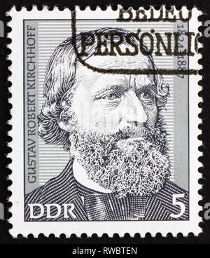 GDR - CIRCA 1974: a stamp printed in GDR shows Gustav Robert Kirchhoff, Physicist, circa 1974 - Stock Photo