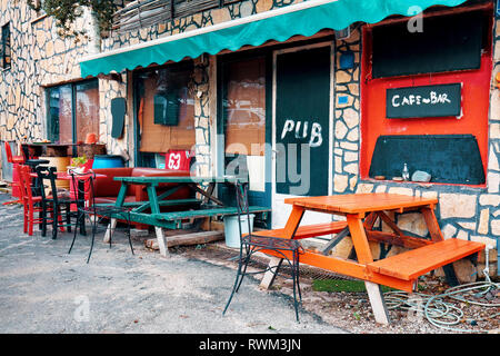 Exterior of a rural vintage cafe bar pub in Bodrum, Gumusluk, Turkey. - Stock Photo
