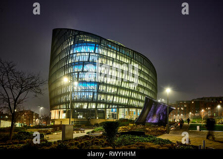 At night the NOMA development One Angel Square landmark head office of the Co-operative Group,  stainable energy credentials architecture - Stock Photo