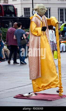 Street entertainer in Trafalgar Square, London, England, UK - Stock Photo