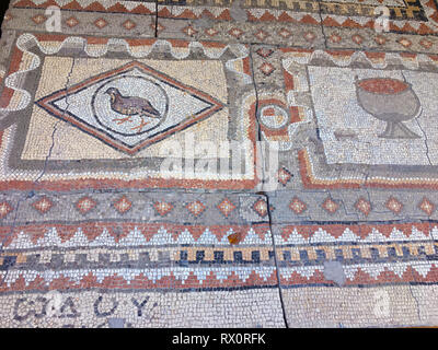 Fragment of an ancient floor mosaic. Colorful small tiles, unusual geometric ornament, floral and regular forms. Crimea Hersones - Stock Photo