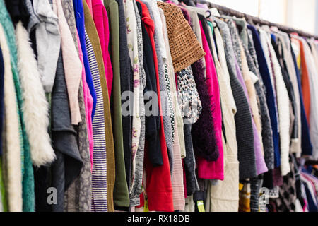 Clothes on hangers in shop. Close up. - Stock Photo