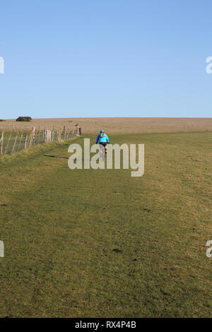 cycling on the south downs national park in east sussex - Stock Photo