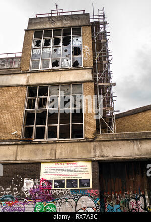 no fly tipping notice on derelict buildings spitalfields east London Architectural decay - Stock Photo