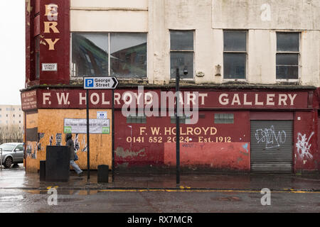 empty derelict buildings on the junction of George Street and High Street Glasgow, Scotland, UK - Stock Photo