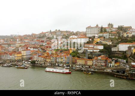PORTO, PORTUGAL - JANUARY 31, 2019: panoramic view of old Porto Oporto city and Ribeira over Douro river from Vila Nova de Gaia, Portugal - Stock Photo