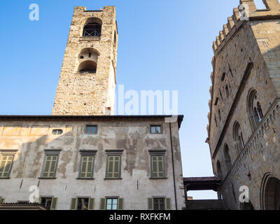 Travel to Italy - view of palace Palazzo del Podesta and Campanone (Torre civica) bell tower from Piazza Duomo square in Citta Alta (Upper Town) of Be - Stock Photo