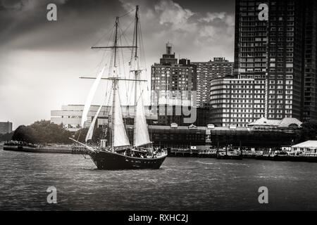 Black and White image of sailboat sailing on Hudson River in Manattan - Stock Photo