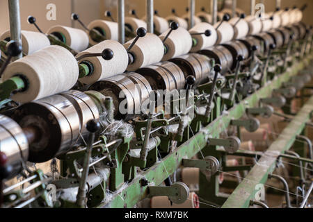 interior of textile factory. Yarn manufacturing.Industrial concept.   - Stock Photo