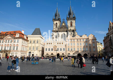 Tourists view the Church of Our Lady Before Týn in Prague Old Town Sqaure (Praha), Czech Republic - Stock Photo