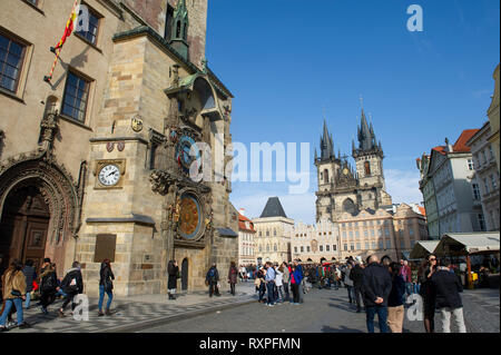 Tourists view the Astornonmical Clock and Church of Our Lady Before Týn in Prague Old Town Sqaure (Praha), Czech Republic - Stock Photo