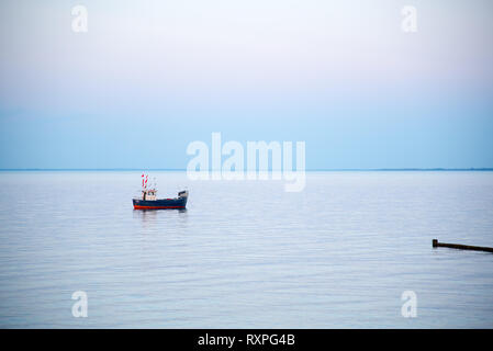 a small fishing boat on the sea - Stock Photo