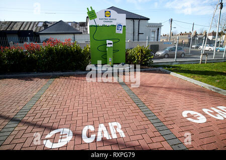 electric car charging point in the car park of a lidl supermarket in Dublin Republic of Ireland europe - Stock Photo