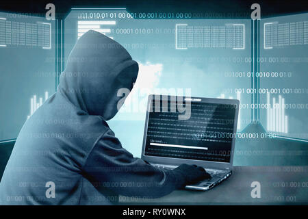 Hacker in black hoodie using laptop on the desk to hacking system with binary code and upload the malware with virtual screen display binary code, bar - Stock Photo