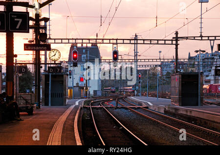 Lausanne train station, Switzerland, at sunset - Stock Photo