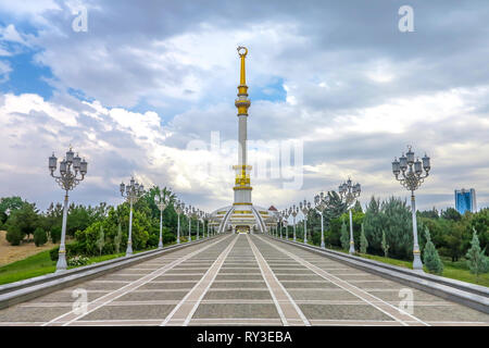 Ashgabat Independence Monument Back View with Cloudy Sky - Stock Photo
