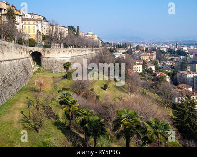 Travel to Italy - street viale delle Mura over Sant Andrea platform of Venetian Walls and view of Lower Town (Citta Bassa) from Porta San Giacomo gate - Stock Photo