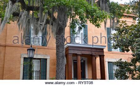 Colorful antebellum house in Savannah, Georgia, USA, orange house facade, historic district, summer, magnolia tree, spanish moss, summer - Stock Photo