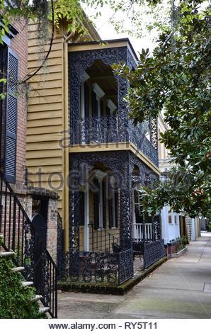 Colorful antebellum houses in Savannah, Georgia, USA, wooden facade, wrought iron railing,historic district,summer, magnolia tree, spanish moss,summer - Stock Photo