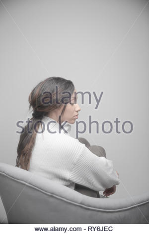 Portrait serene beautiful Jamaican young woman with long hair - Stock Photo