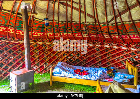 Tash Rabat Caravanserai Traditional Kyrgyz Yurt Interior with Stove and Sleeping Bed - Stock Photo