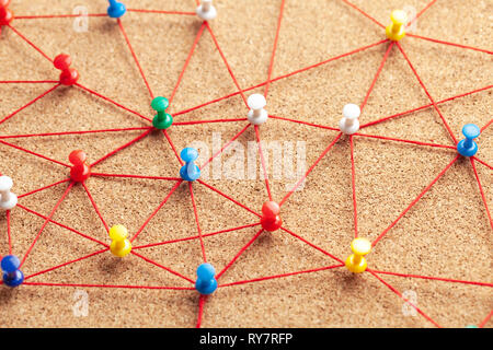Business team. Connect between people. Office pins connected by red thread - Stock Photo
