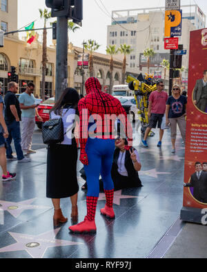 Hollywood Walk of Fame. Street artists, and tourists walking and taking photos on Hollywood Boulevard, Los Angeles, October 14, 2016 - Stock Photo