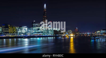 The Shard, London England. March 13 2019. The famous landmark lit up at night time across the Thames in the centre of the city - Stock Photo