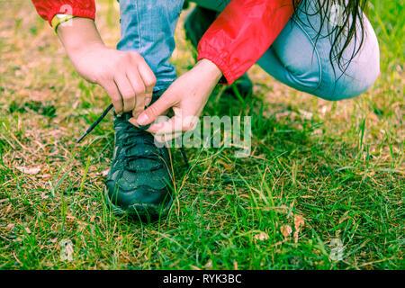 Photo of woman tying shoelaces - Stock Photo